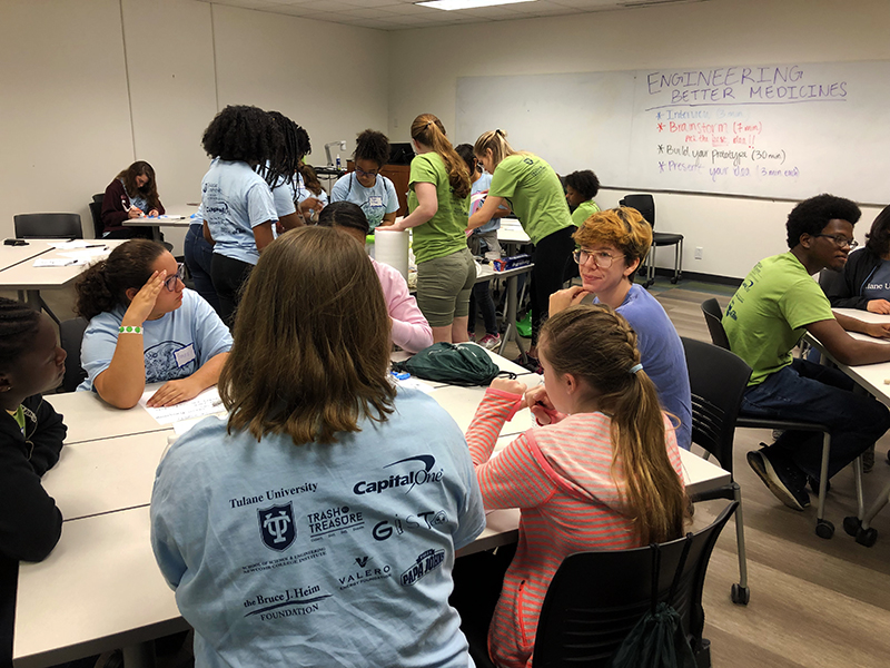 Girls participating in hands-on workshop led by GC Scholars at GiST